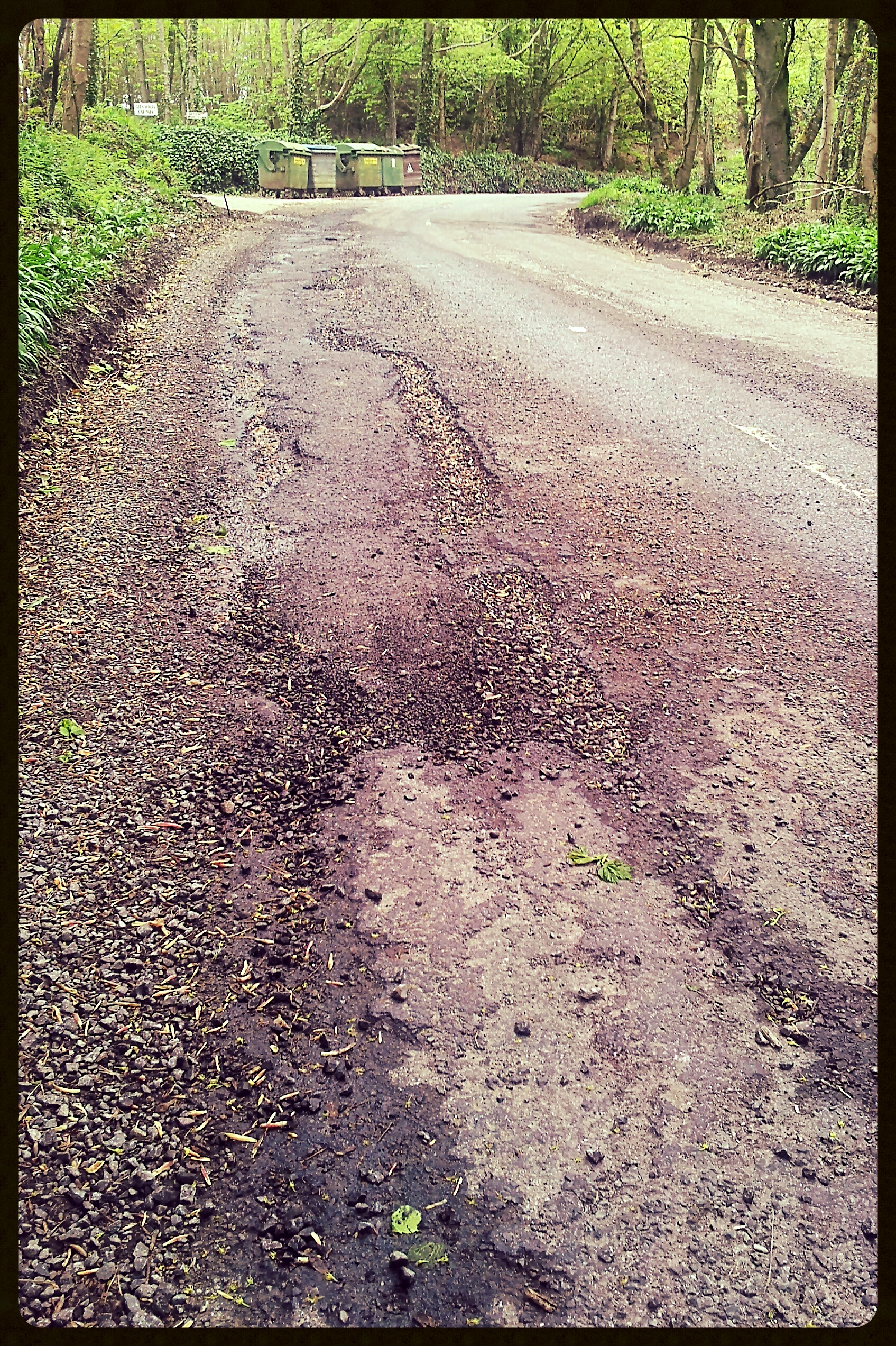 tarmac road surface showing serious erosion due to