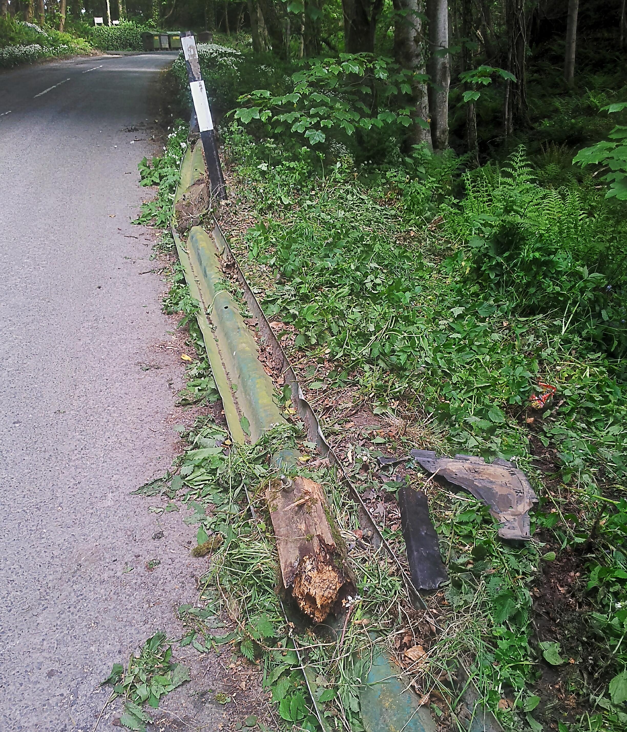 damaged crash-barrier beside the B738 Dunskey Road