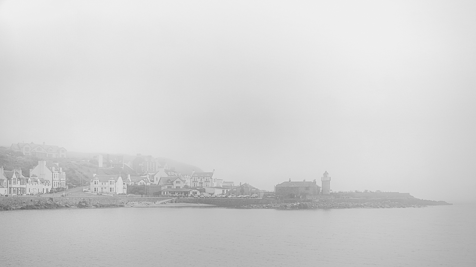 A moderate haar from the sea, obscuring the village in the distance.