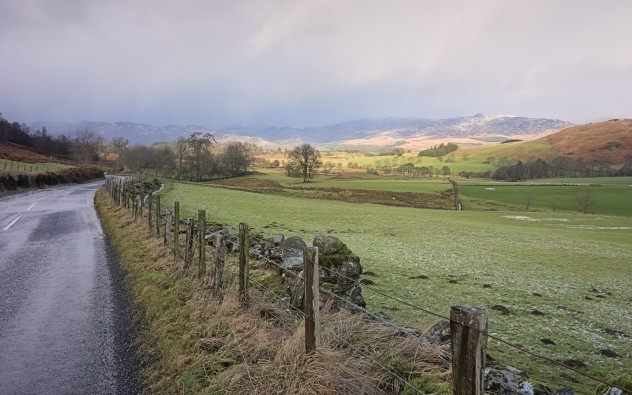 Sunshine and snow passing over the hills of Strathearn