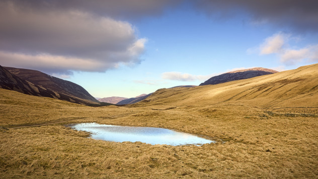 A blue-sky day: clouds reflecting of a small pond, Glen Clunie.