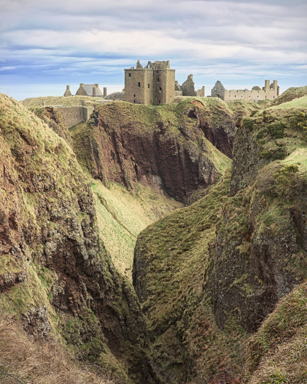 A classic view from a small bridge along part of the gorge to the south of Dunnottar Castle.