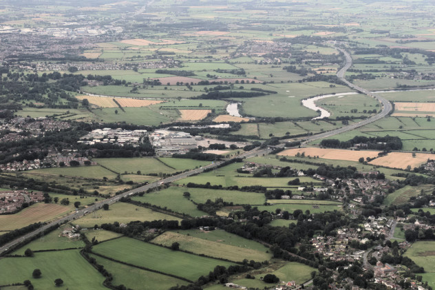 Flying over the River Eden at Weatheral looking at the M6 and Carlisle in the distance.