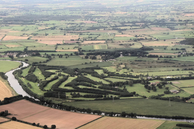 Flying: above Hayton Hall Castle  Not so much an ornamental garden as a golf-course amongst a labyrinth of trees
