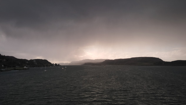 Sunlight and clouds over Kerrera whilst leaving Oban.