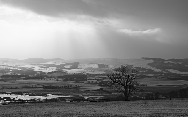 Clouds and passing crepuscular rays above Forteviot on a wintry day.