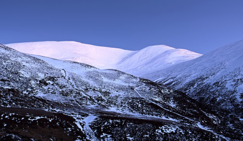 The first star coming out - the snow on Leacann Dubh and Creag Leacach glistening in cold light of winter's dusk.