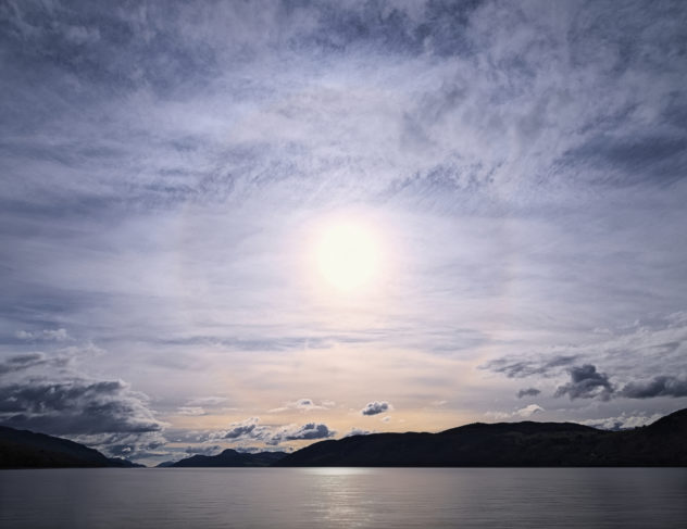 It's amazing what you can capture with a 7-14mm lens - an entire 22-degree solar halo with plenty room to spare.  Taken on the beach at Dores looking south-west along Loch Ness.