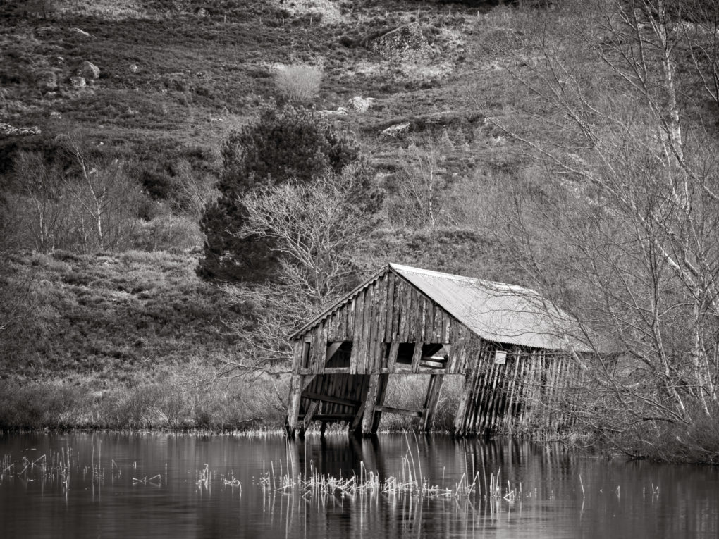 Ruins of a boathouse, Loch a Clachain backing onto Creag Bhuidhe.