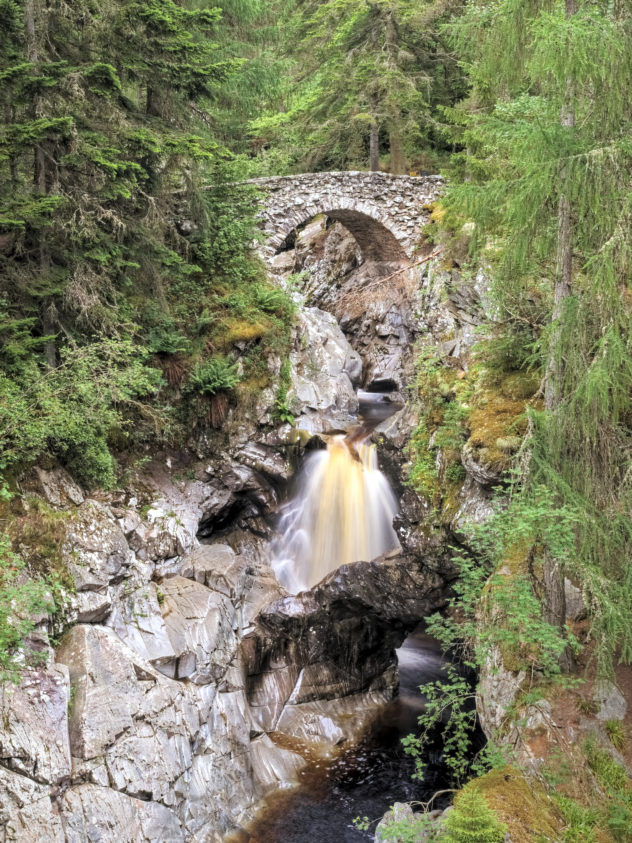 A well-known scene: looking up the gorge approaching the lower bridge at the Falls of Bruar.
