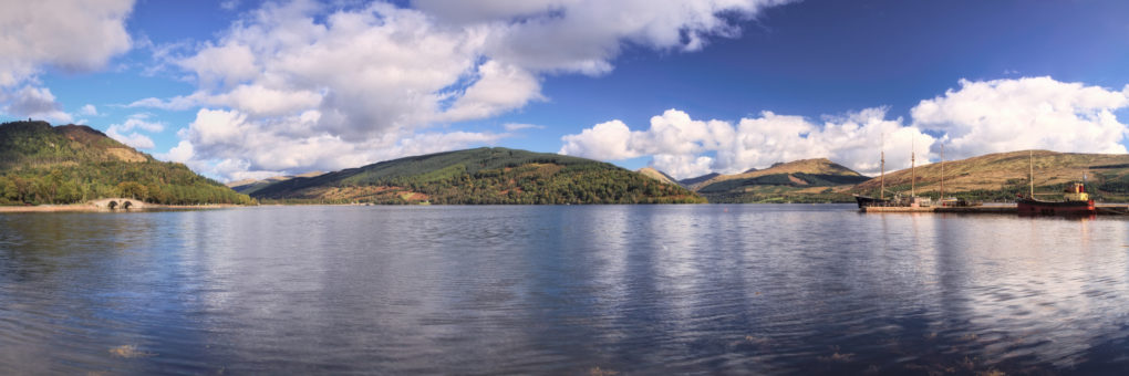 A wide-angle panorama of Loch Shira and Loch Fyne from the front at Inverary.