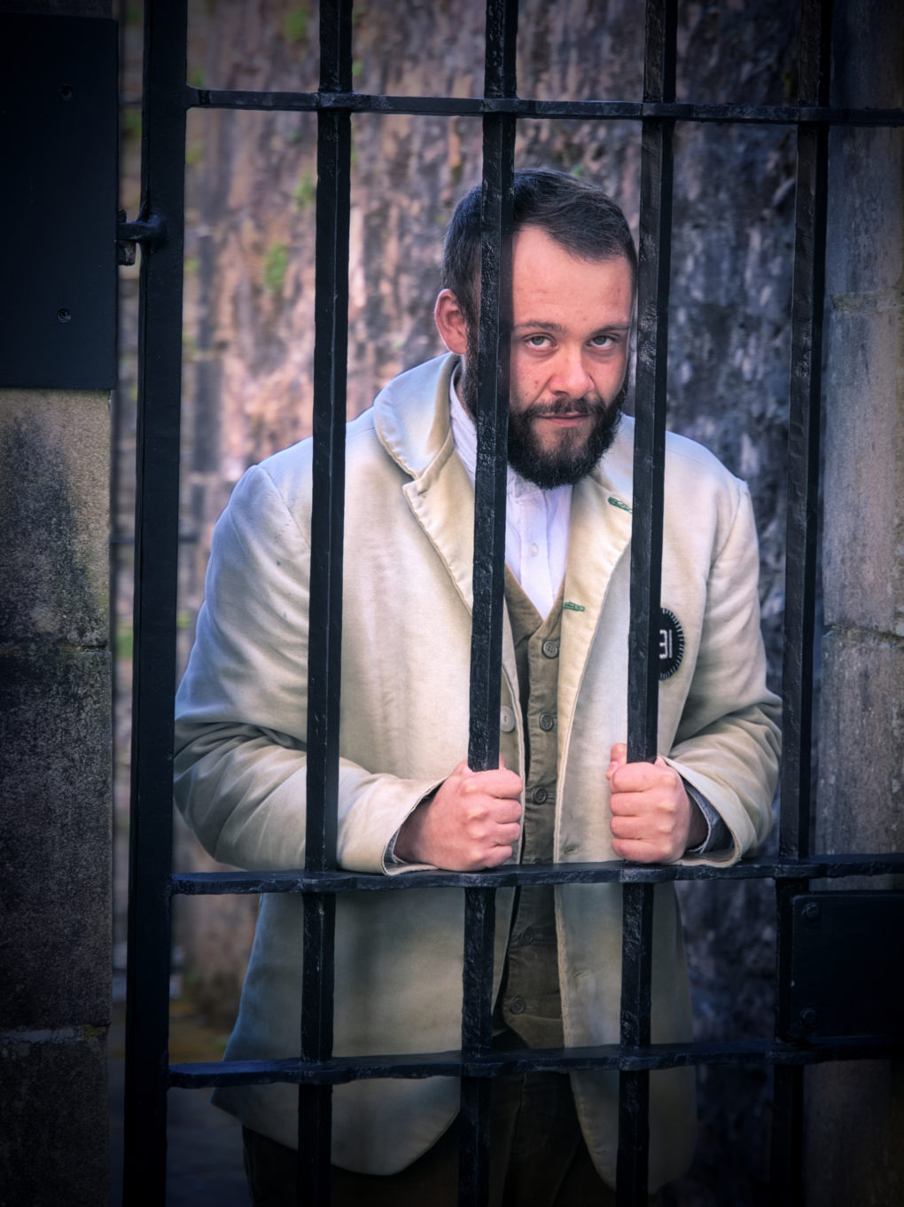 One of the guides in Inverary Jail pretending to have been naughty.