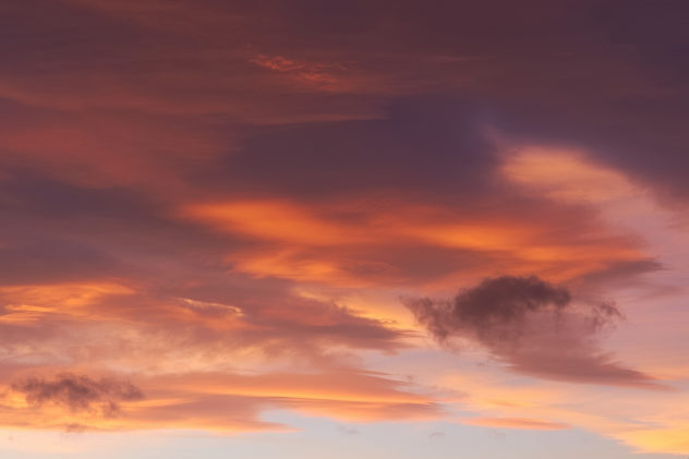 Fading lenticular clouds illuminated by a stunning sunset