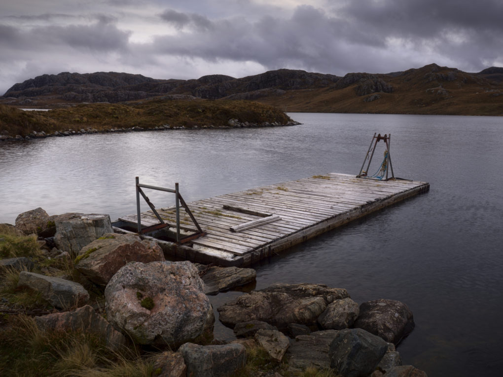 Some kind of wooden pier/jetty thing (possibly for fishing?) on the edge of Loch Tullie