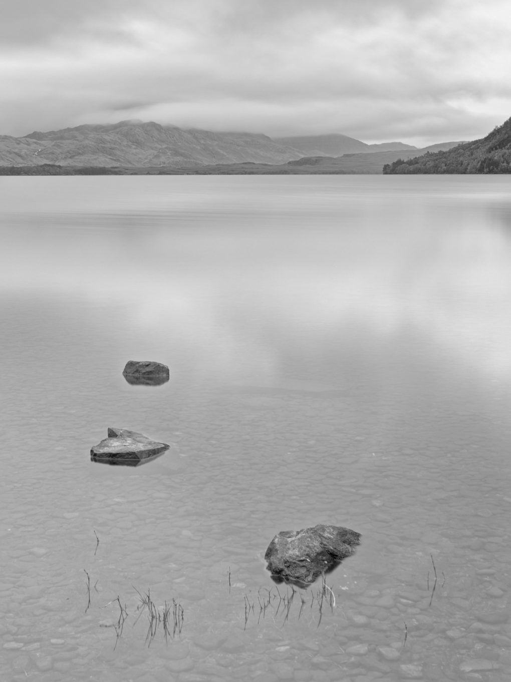 On the shore of Loch Maree at Slattadale, looking toward Slioch in the distance.  As I was here, there was a fellow cooking breakfast a few yards along the little beach - the smell of fried bacon rashers wafted past on the breeze...