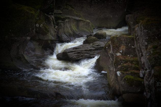 Detail of the Keltie Water flowing through rocks (diamicton till in the Highland Boundary Fault zone), Bracklinn Falls outside Callander