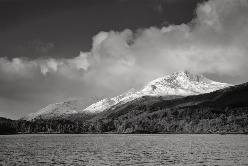 Bright pure white snow catching the morning light on the undulating slopes of Sgurr na Lapaich across Loch Beinn a Mheadhoin