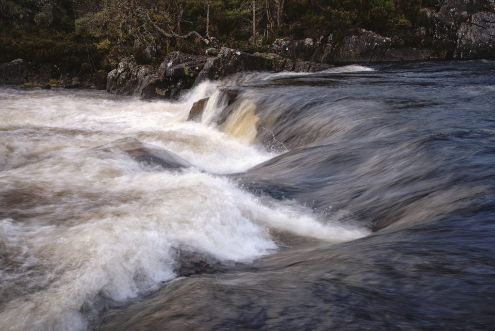 Fast-flowing cascades in the River Affric.