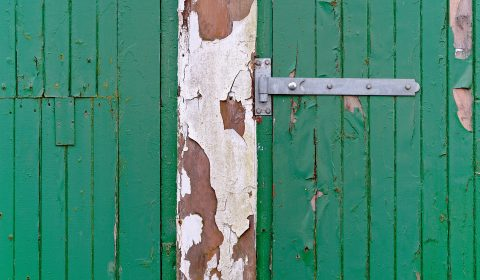 We like flaking paint texture. Green garage doors in the middle of Altnaharra