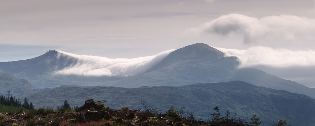 A large foggy cloud flowing over Stob Binnein and Ben More outside Crianlarich, from Lix Toll near Killin.