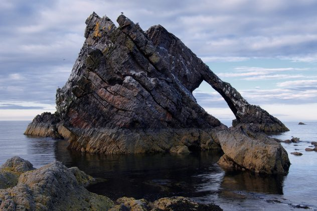 The classic well-known composition, a view along the natural arch at Bow Fiddle rock, Portknockie.