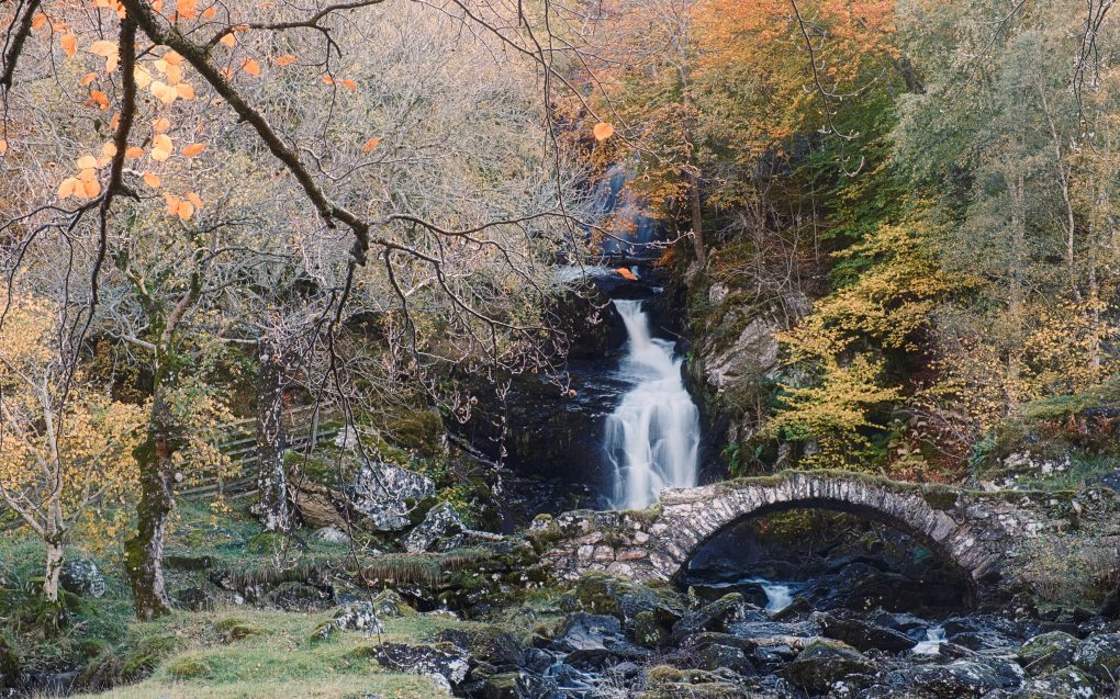A well-known waterfall (much taller than it looks in most photos) behind a packhorse bridge, Glen Lyon.