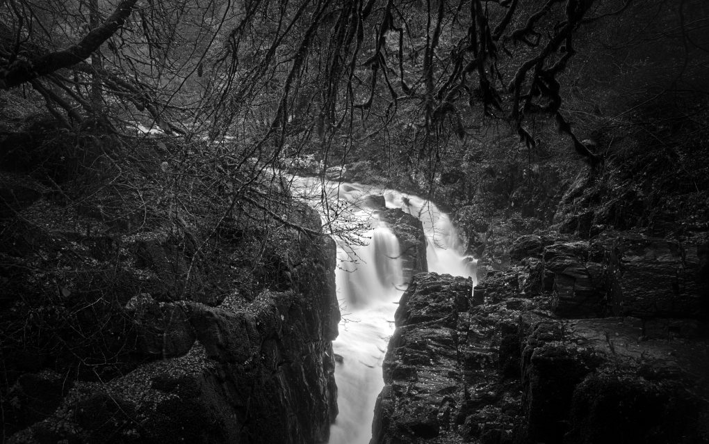 A classic view of the Black Linn waterfall in the River Brann at the Hermitage in late autumn.