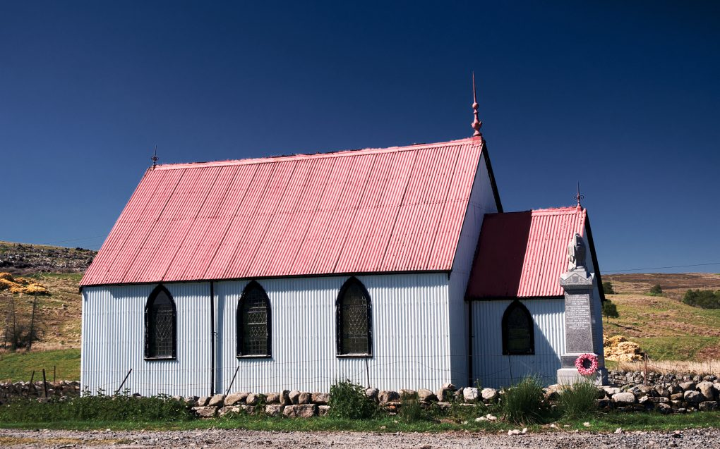 Despite its dimunitive scale, this church bulding by the roadside in Strathnaver for its corrugated iron construction and high-contrast decoration in bright red roof, white walls and black window frames and other outlines.  It was built in 1891 by the Free Church of Scotland as a mission church to serve the Sutherland estates. In 1900 it became United Free before joining Church of Scotland in 1929.